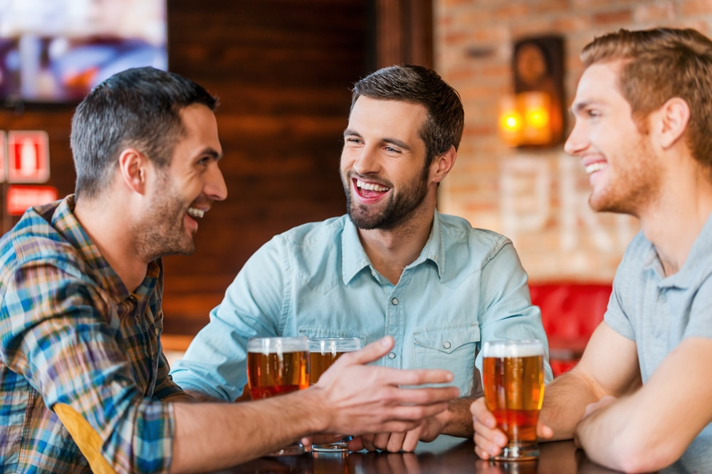 Friends enjoying beer at one of the top Brattleboro Restaurants for 2021